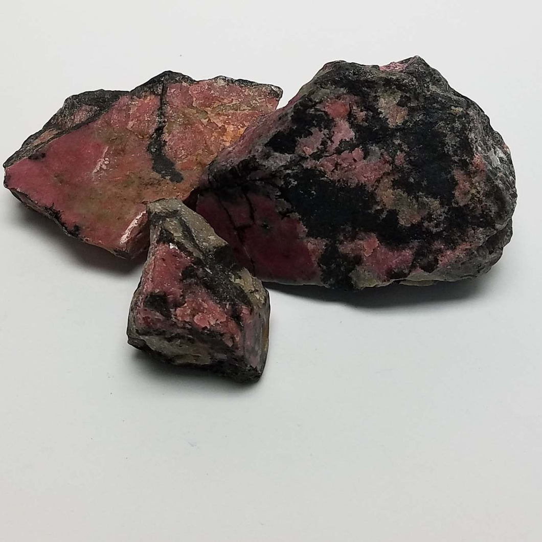 Rough Rhodonite Chunks, One Face Polished