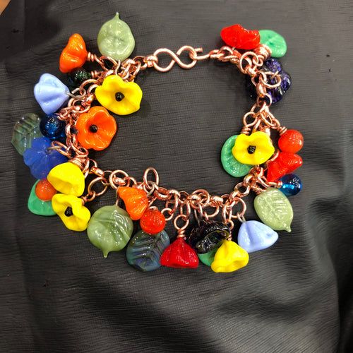 Flower charm bracelet.  Summer time colors.  Copper bracelet with glass flowers