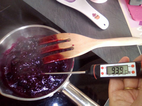 Recipe of blueberry jam with cooking thermometer