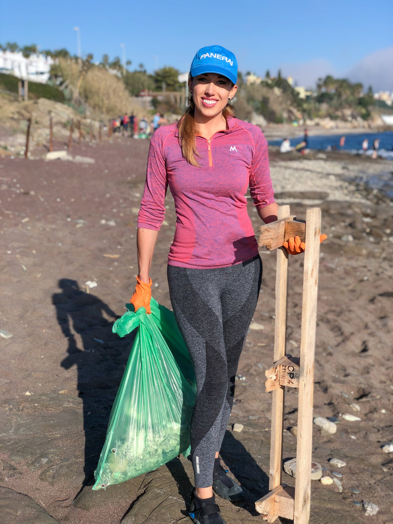 sporty girl Laura Brunereau collecting garbage from the shore