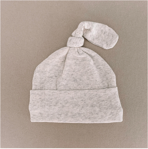 gray newborn beanie with knot on beige background