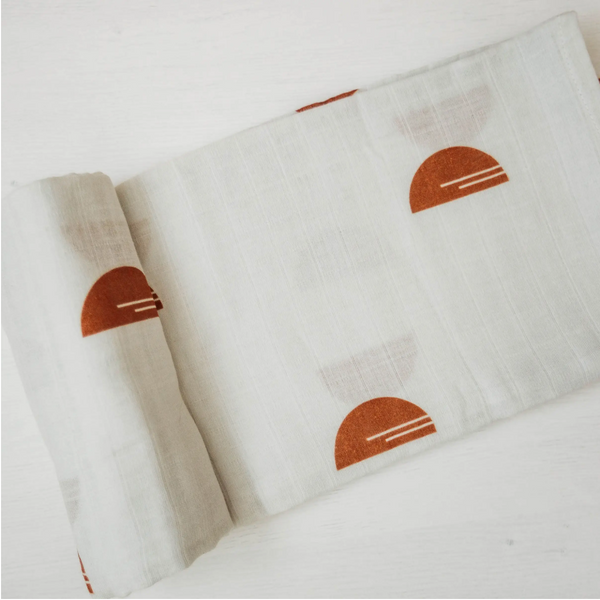100% cotton cream blanket with rust colored half circles