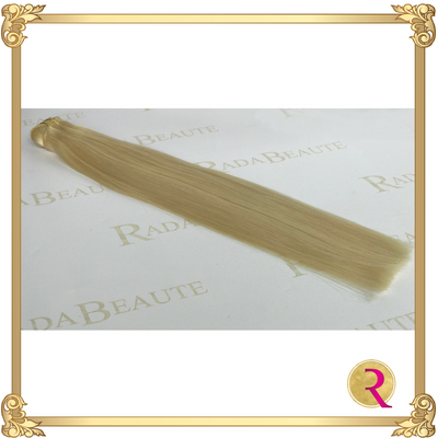 Butterscotch Blonde Weave Extensions side view. Buy now at Rada Beaute.