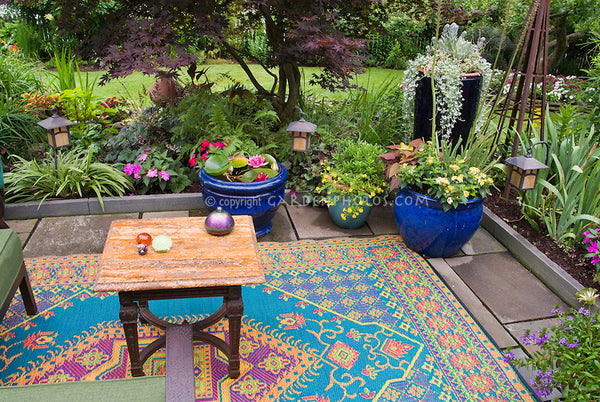 antique rug in outdoor garden room
