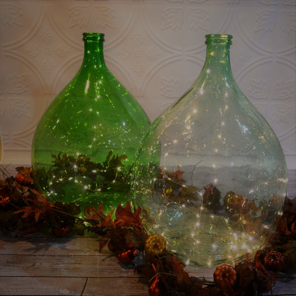 antique hand-blown green glass demijohns