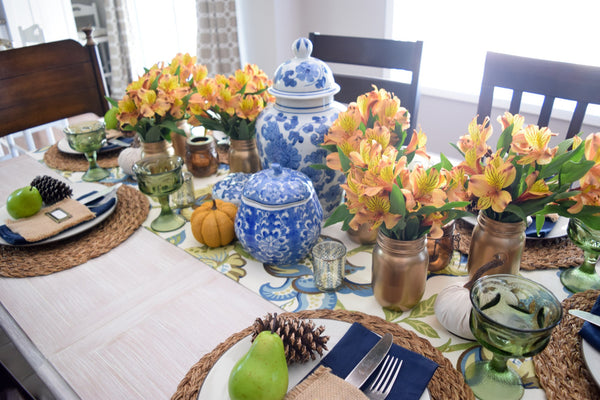 antique ginger jars in a fall tablescape
