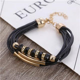 HAND WOVEN LEATHER BANGLES WITH EUROPEAN CHARMS