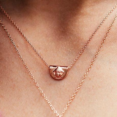 Rose gold buddha pendant byron bay
