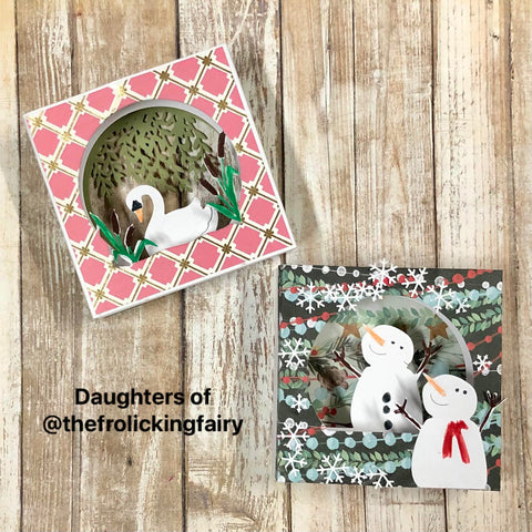 #thefrolickingfairy #i_crafterart #icrafter #tunnelcard #tunnelcardbase #tunnelcardbaseswan #tunnelcardaddon #snowglobe #letitsnow #interactive #interactivecard #christmasinjuly #nontraditionalcolors #diecutting #patternedpaper #dimensional #diorama #cardmaker #cardmaking #cardmakersofinstagram