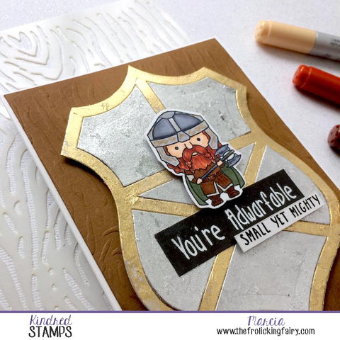 #thefrolickingfairy #kindredstamps #sizedoesntmatter #dwarf #warrior #shield #tonicstudios #gildingflakes #longjourney #adwarfable #smallyetmighty #copiccoloring #dryembossing #woodgrain #stencil #papercraft #handmade