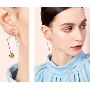 Simple and versatile, simple design, metal notes, pearl like earrings, ear clip, no ear hole, female, cold personality in Europe and America
