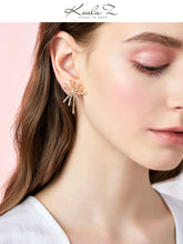 Load image into Gallery viewer, Thick plated real gold, cool wind, advanced design sense, divergent metal coral earrings, ear clips, no ear holes, women in Europe and America
