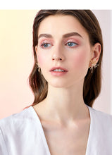 Load image into Gallery viewer, Thick-plated real gold cold wind high sense design sense divergent metal coral earrings earrings no ear hole female Europe and the United States
