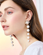 Load image into Gallery viewer, Design of Europe and the United States exaggerated cold wind Long-looking mermaid's tear metal shell looks like a pearl earring ear clip