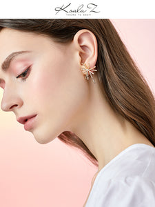 Thick-plated real gold cold wind high sense design sense divergent metal coral earrings earrings no ear hole female Europe and the United States