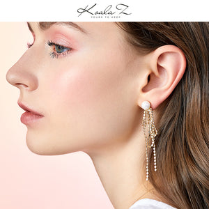 Design sense: round face, thin metal fringe, bow knot, pearl like long earring, ear clip, no ear hole, female Japan