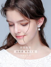 Load image into Gallery viewer, Special price rose pearl Pendant Earring clip European and American earless female transparent silicone cushion