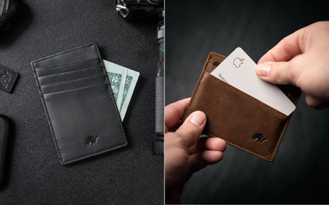 A black leather wallet holding a few dollar bills & pulling out a business card from their brown leather wallet