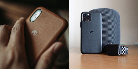 A blue leather iPhone case standing against a speaker next to an Apple watch