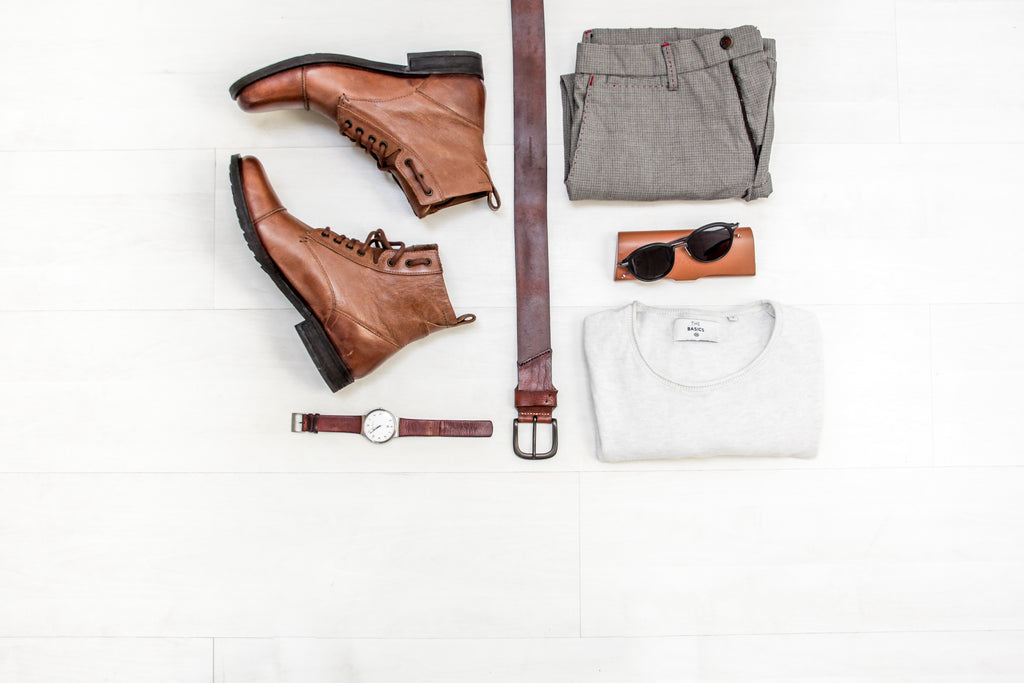 flatlay of leather belt, handmade leather watch strap, and a men's casual outfit