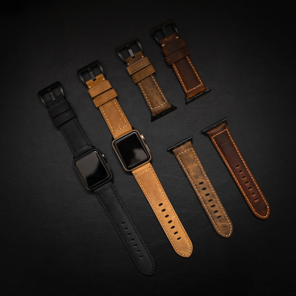 Flatlay of Bullstrap leather Apple watch straps on black background