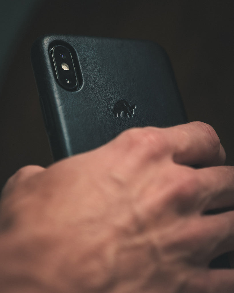 Blue premium iphone case being held by a man