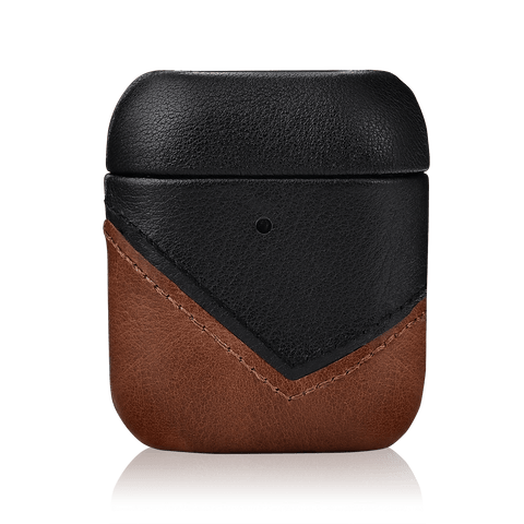 A genuine leather Airpods case placed on a plain, dark background