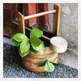 green leaves in tea ceremony water bucket