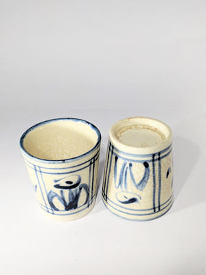 antique ceramic sake cups in crackled cream glaze with blue flower and rain patterns available at zenbuhome.com
