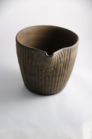 Handmade ceramic sake pourer in bronzed chocolate glaze from Zenbu Home