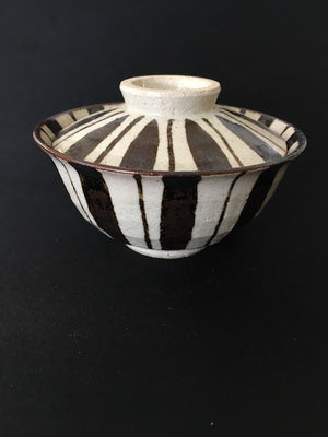 Striking handmade Japanese ceramic bowl with lid in coffee and cream glaze available at Zenbu Home