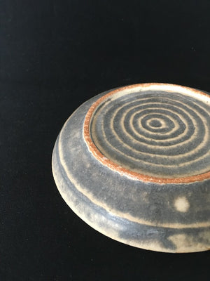 The alluring deep earth plate is a handmade ceramic from Kyoto Japan