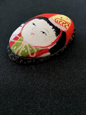 Handmade Japanese brooch in vintage silk kimono fabric with Ningyo doll motif