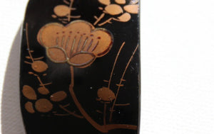 Japanese black lacquerware pendant with gold plum blossoms