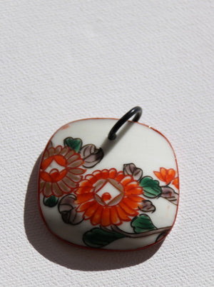 Pretty Japanese floral pendant made from vintage ceramic with red chysanthemum