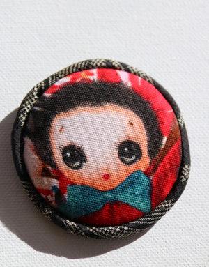 Wide eye Japanese doll brooch
