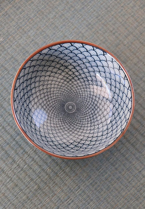 Hypnotic repeating blue and white Japanese wave patterned ceramic dish