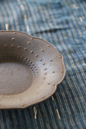 This handsome, hand-crafted iron dish from Japan can be found at Zenbu Home