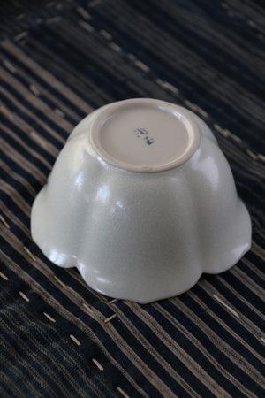 Buy this elegant, pale celadon-green flower-shaped Japanese ceramic dish at Zenbu Home