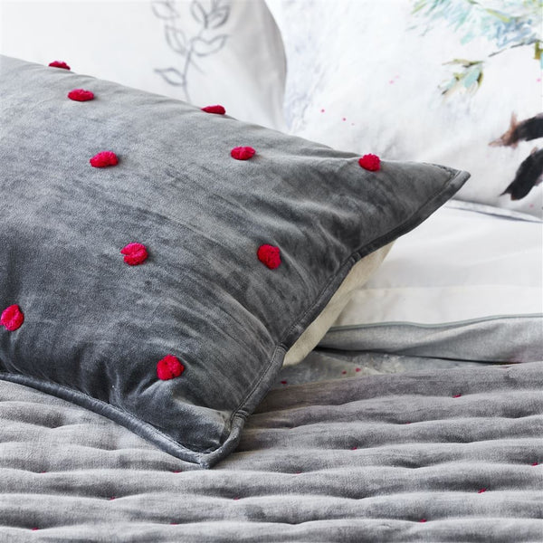 Designers Guild Sevanti Graphite Rectangular Quilted Cushion With Pom Poms