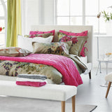 Designers Guild Sevanti Fuchsia Square Quilted Cushion With Pom Poms