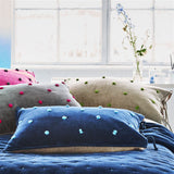 Designers Guild Sevanti Indigo Rectangular Quilted Cushion With Pom Poms
