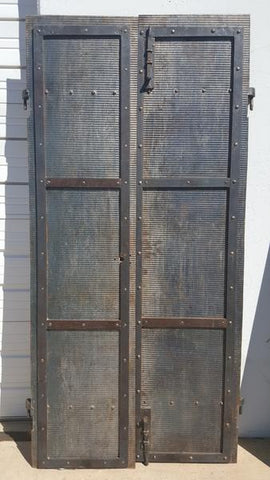 Pair of Iron Storm Shutters