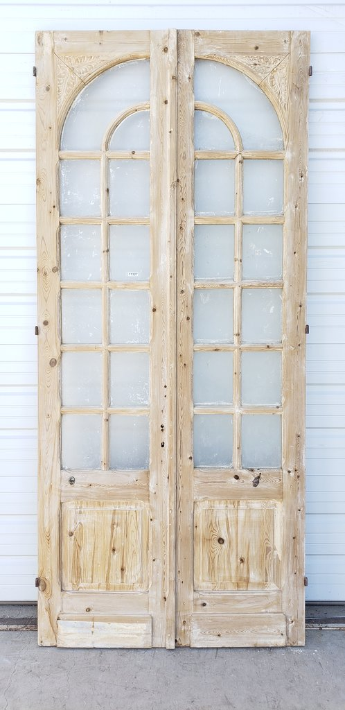 Pair of Wood Doors with 12 Arched Glass Panes Each
