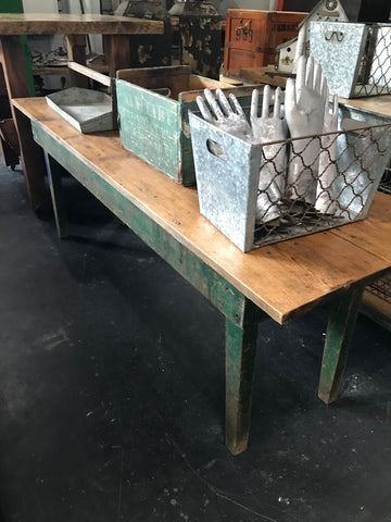 Long wood table with green legs