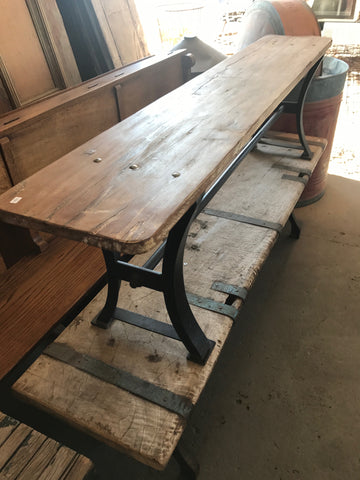 Wooden bench with iron legs
