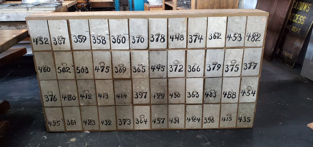 48 Numbered Metal Drawers in Wood Cabinet