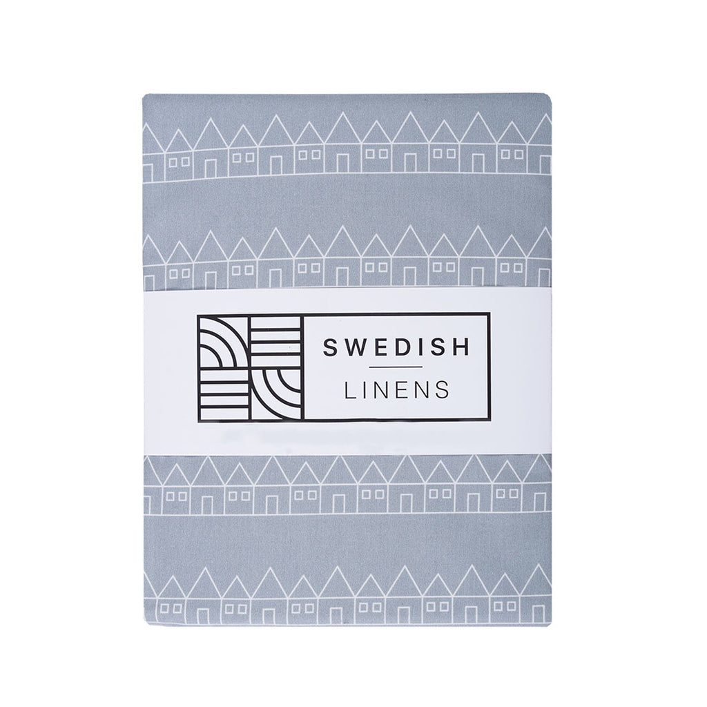 Crib sheet in organic cotton grey packaging