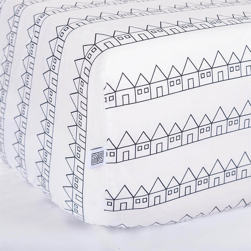 White baby bedding fitted sheet with houses