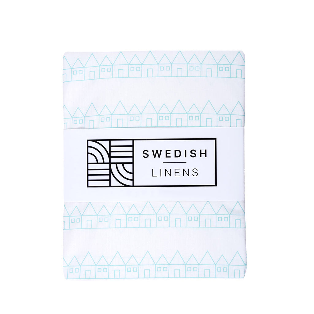 Organic crib sheet white and blue in packaging
